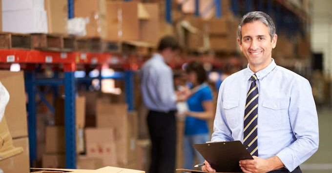 An owner of a manufacturing company in the warehouse