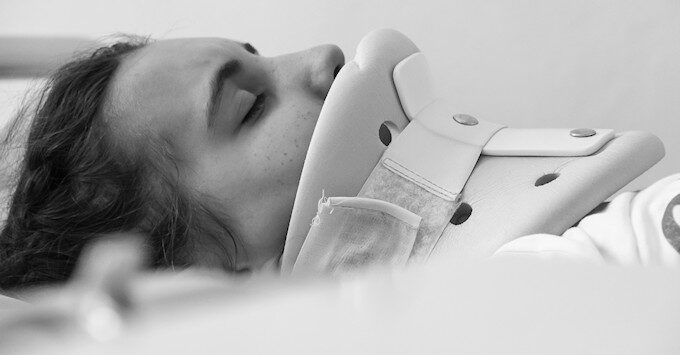 Patient in a neck brace